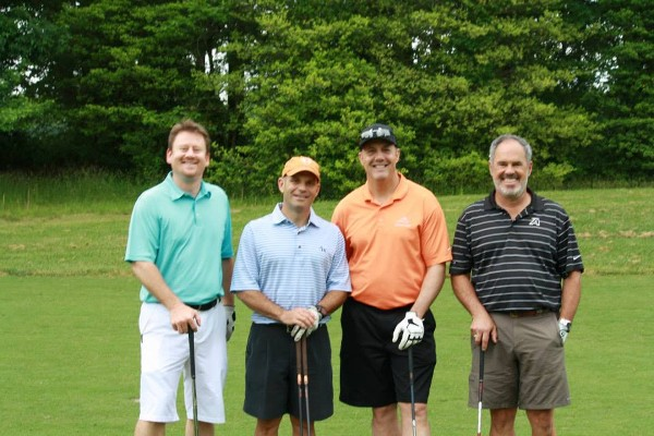 A team takes the course during the chapter's golf tournament in May, which raised funds for scholarships and grants.